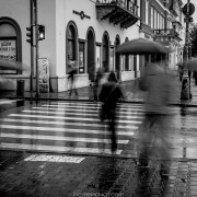 People commuting from work to home... and under the rain. Cluj-Napoca, Romania, 2014.