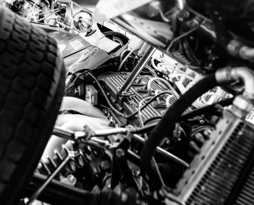 Autoportrait in the rear mirror of a Matra MS11 (1968) with its V12 engine. Matra museum, Romorantin, France, 2015.
