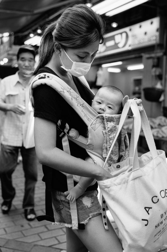 Motherhood. Ameyoko shopping street, Ueno, Tokyo, Japan.