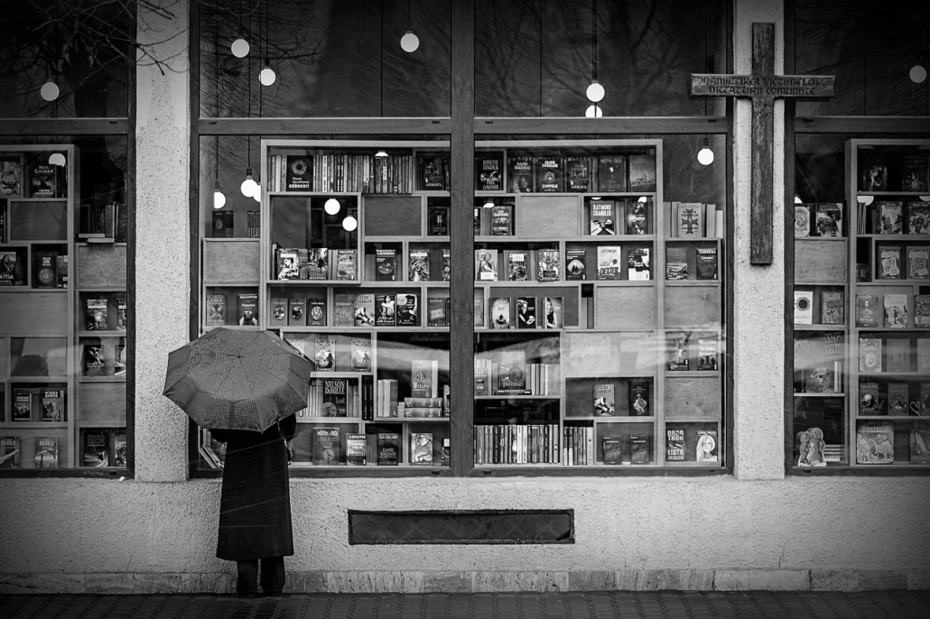 The book shop, the cross and the umbrella. Cluj-Napoca, Romania.