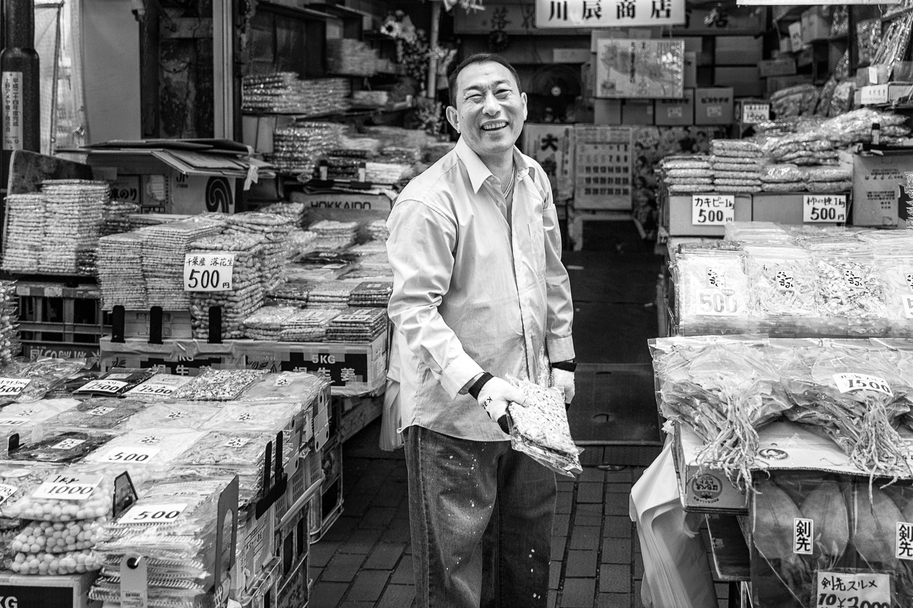 Smily dry fish seller in Ameyoko shopping street, Ueno, Tokyo, Japan.